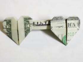 怎么折纸心连心图解 美元折心连心的折法