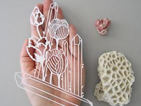 很立体的平面纸雕作品 仿佛从石头上雕刻而成