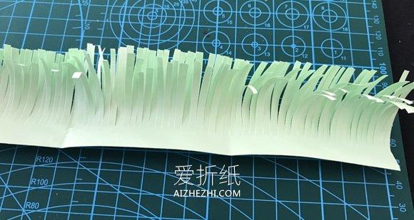 怎么用彩纸做圣诞花环的简单方法教程- www.aizhezhi.com