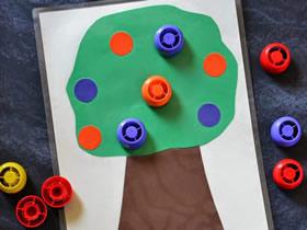 怎么用卡纸和瓶盖做果树粘贴画的方法图解